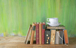 Vintage books with a cup of coffee Royalty Free Stock Photos