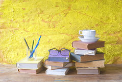 Vintage books with cup of coffee, specs and pens, free copy spac Royalty Free Stock Images