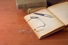 Vintage books with glasses Stock Photos