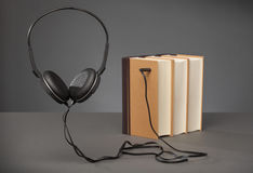 Vintage books on grey background with a Headphone, concept for A Royalty Free Stock Photo