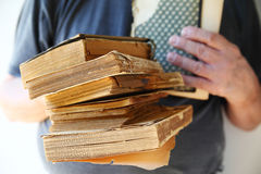 Vintage books held by man Stock Images
