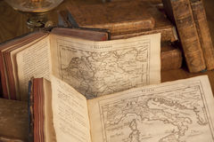 Vintage books with old maps. Standing on a wooden table Stock Photo