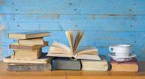 Vintage books one opend Royalty Free Stock Photos