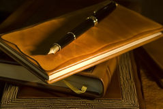 Vintage books and pen Royalty Free Stock Photos