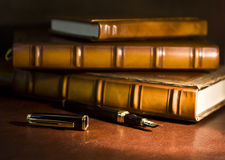 Vintage books and pen Royalty Free Stock Images