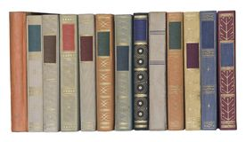 Vintage books in a row, isolated, free copy space. Vintage books in a row, isolated on white backgrond, clipping path, empty labels with free copy space Stock Image