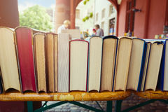Vintage books on a shelf in a shop market Royalty Free Stock Photos