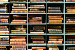 Vintage books on shelves. In cubbies royalty free stock image