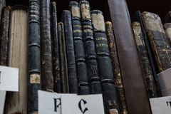 Vintage books. On the shelves in a library Royalty Free Stock Photos