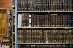 Vintage books. On the shelves in a library Royalty Free Stock Images
