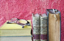 Vintage books and spectacles, close up royalty free stock images