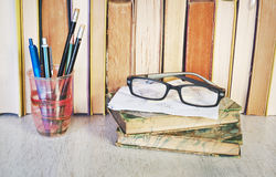 Vintage books, spectacles and pens, Royalty Free Stock Image
