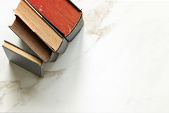 Vintage books. Stacked framing white marble copy space Royalty Free Stock Photo