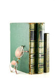 Vintage books stacked and glasses