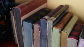 Vintage books. View of row of old books and vintage typewriter.  stock video