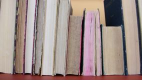 Vintage books. View of row of old books and vintage typewriter.  stock footage