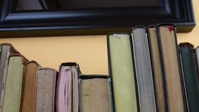 Vintage books. View of row of old books and vintage typewriter stock video