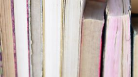 Vintage books. View of row of old books and vintage typewriter stock video footage