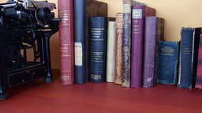 Vintage books. View of row of old books and vintage typewriter. Books in Czecch and German language. stock video footage