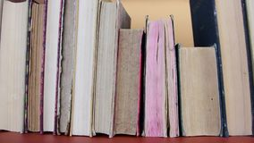 Vintage books. View of row of old books and vintage typewriter. stock video footage