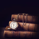 Vintage books and a watch Stock Photos