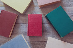 Vintage books on wooden background. View from above Stock Photo