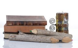 Vintage books, wooden pencils and candle Royalty Free Stock Photo