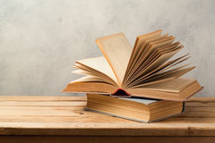Vintage books on wooden table stock photography