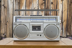 Vintage Boombox on Table with Rustic Cabin Wall Royalty Free Stock Image