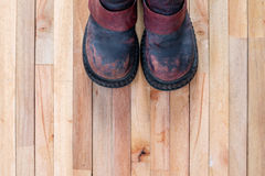 Vintage boot on top of grunge wooden Royalty Free Stock Photo