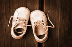 Vintage boots. Childish pair of boots on wood, vintage or retro concept Royalty Free Stock Photo