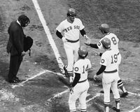Vintage Boston Red Sox. Red Sox slugger Dwight Evans is congratulated by teammates Carl Yastrzemski (8), Fred Lynn (19) and Jim Rice (14). (Image from B&W slide Stock Images
