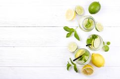 Summer healthy non virgin mojito cocktail, citrus infused water drinks, lemonades with lime lemon or orange, diet detox beverage. royalty free stock photos