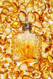 Vintage bottle and yellow amber stones. Vintage bottle on a background of yellow amber stones Stock Photography