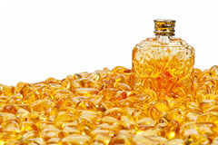 Vintage bottle and yellow amber stones. Vintage bottle and stones yellow amber on a white background Stock Photo