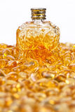 Vintage bottle and yellow amber stones. Vintage bottle and stones yellow amber on a white background Stock Image