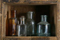 Vintage bottles. Ancient bottles in a wooden box royalty free stock photo