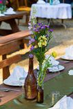 Vintage Bottles and Flowers Centerpieces Stock Images