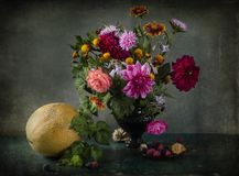 Still life with bouquet of autumn colors in a vase Royalty Free Stock Photo