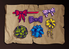 Vintage bow-knots on old paper background. Royalty Free Stock Image