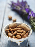 Vintage bowl full of almonds Stock Image