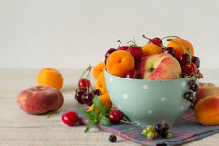 Vintage bowl with summer fruits Royalty Free Stock Photos
