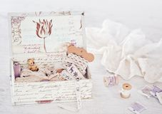 Vintage box with laces, ribbons and threads Stock Image