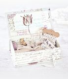Vintage box with laces, ribbons and threads Royalty Free Stock Photo