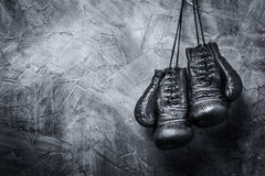 Vintage boxing gloves. Hanging on the old wall royalty free stock photo