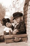 Vintage boy in sepia. Vintage photo of a little boy and his dog Stock Photo
