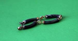 Vintage bracelet on green Royalty Free Stock Photos