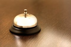 Vintage brass bell. On hotel bellstand Stock Image