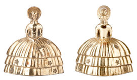 Vintage brass bell shape of a woman Stock Image