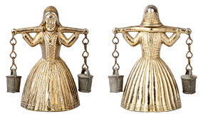 Vintage brass bell shape of a woman with a yoke Royalty Free Stock Photo